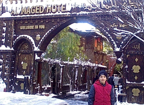 Al-Majed Hotel in the snow, and my friend's son