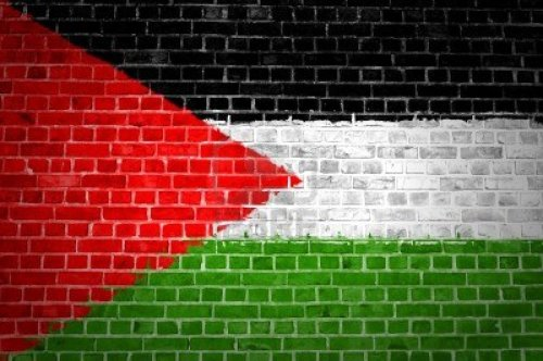 12422706-an-image-of-the-palestine-flag-painted-on-a-brick-wall-in-an-urban-location