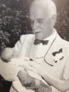 Doctor Proxmire with a baby he delivered, 1955
